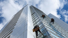 Worker cleaning windows on height Stock Photo