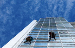 Worker cleaning windows on height Stock Photos