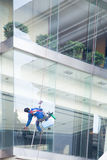 Worker cleaning windows service Stock Images