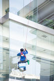 Worker cleaning windows service Stock Photos