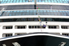 Worker cleans Cruises ship window Royalty Free Stock Photos