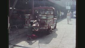 Worker Cleans Jeepney. PHILIPPINES, CITY OF LAS PINAS, APRIL 1978. A Male Worker Cleans The Back Of A Jeepney At The Sarao Motors Manufacturing Plant, With stock video footage