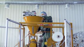 Worker cleans machine with vacuum cleaner. Worker cleans the machine for making tea. He`s using vacuum cleaner and cleans the equipment from dust and dirty stock video