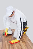 Worker cleans with sponge and spray Stock Photo