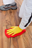 Worker cleans wooden floor Royalty Free Stock Photos