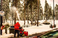 Worker Clearing Snow At Rest Area Royalty Free Stock Images