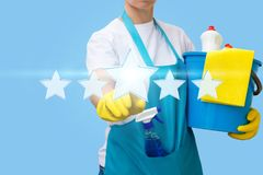 Worker clicks on the star. The concept of rating the cleaning stock image