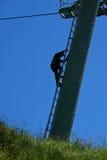 Pole Climber. A worker climbing a pole of a ski lift Stock Images