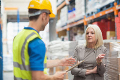 Worker with clipboard speaking with his manager Royalty Free Stock Photo
