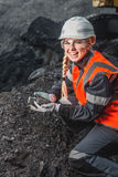 Worker with coal in the hands Royalty Free Stock Image
