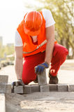 Worker with cobbles Royalty Free Stock Image