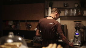 Worker of coffee shop making coffee for guests.  stock footage