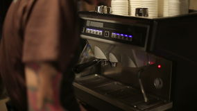 Worker of coffee shop making coffee for guests stock video footage