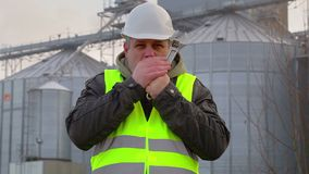 Worker cold at outdoors near the factory stock video footage