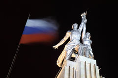 Worker and Collective Farm monument in Moscow. At night, hammer and sickle, russian flag Royalty Free Stock Photography
