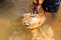 Worker collects the mineral at the river Royalty Free Stock Photos