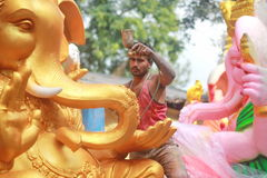 Worker colouring Ganesh idol in hyderabad, India Royalty Free Stock Images