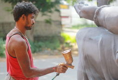 Worker colouring Ganesh idol in hyderabad, India Royalty Free Stock Image