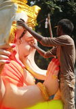 Worker colouring Ganesh idol in hyderabad, India Royalty Free Stock Photography