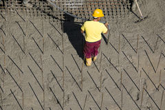 Worker on concrete background Stock Photography
