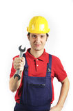 Worker confidence. Mechanic keeping a wrench in his hand meaning confidence Royalty Free Stock Image