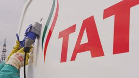 Worker Connects Pipes at Tatneft Refuel Station stock video
