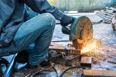 Worker in constructing industry grinding metal. The worker in constructing industry grinding metal Royalty Free Stock Photos