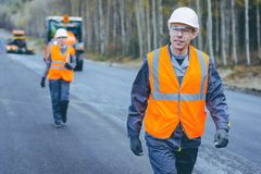 Worker construction build. Road engineer highway service Royalty Free Stock Image