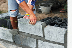 Worker construction laying concrete blocks. On wall project Stock Photography