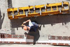 Worker at construction site. An overhead view of a worker at a construction site stock photo