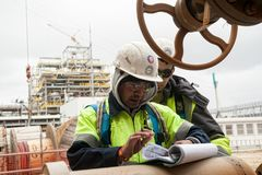 Worker on a construction site check documents Royalty Free Stock Photos