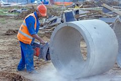 Worker cuts the concrete ring stock photos