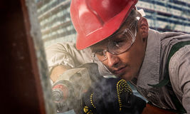 Worker at a construction site. Worker at the construction site drilled concrete Royalty Free Stock Photo