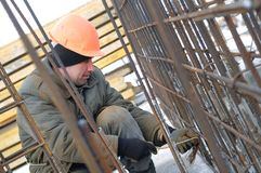 Worker at construction site making Stock Images