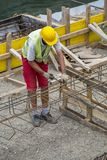 Worker at the construction site making reinforcement metal Stock Photo