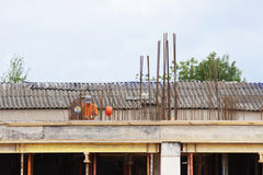 Worker at a construction site for the  of the polyclinic in the city. Royalty Free Stock Images