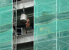Worker at a Construction Site Unloads Cement Royalty Free Stock Photos