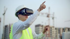A Worker on Construction site with VR glasses smart city.