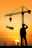 Worker construction at sunset Royalty Free Stock Photo