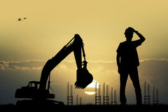 Worker construction at sunset Stock Images