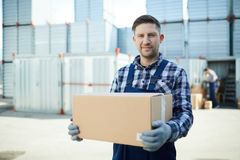Worker at container storage area stock images
