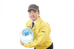 Worker with a container of water Stock Photography