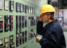 Worker in a Control Room Royalty Free Stock Photos