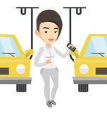 Worker controlling automated assembly line for car Stock Photography