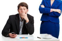 Worker during controlling by boss. Thoughtful male worker during controlling by his boss Stock Photo