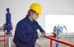 Worker controls devices Stock Images