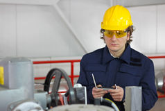 Worker controls devices royalty free stock photography