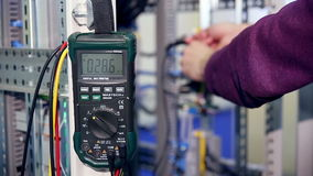 A worker controls electrical equipment on a factory with modern equipment. stock footage