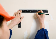 Worker with corner and pencil Royalty Free Stock Photo