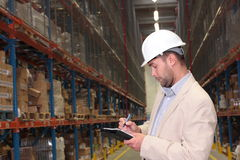 Worker counting stocks Stock Photos